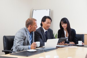 Business people using tablet in meeting